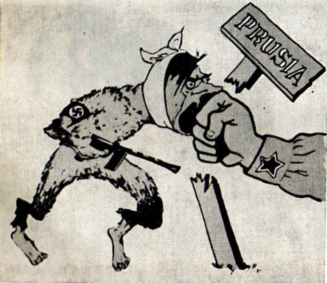 """Fig. 15: """"Pumnul în gura fiarei fasciste"""", Jules Perahim, 1945, imagine reprodusă în Cronică ilustrată a unei lumi apuse (Editura Politică, 1959), p. 208."""
